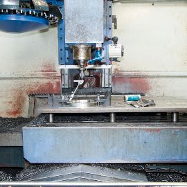 CNC machine making a part